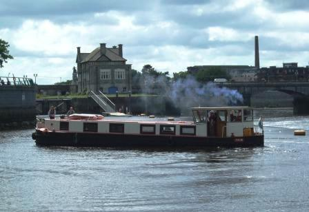 74M executes a three point turn before coming into moor.  Rowing Club in background.